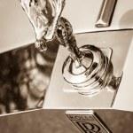 "BERLIN, GERMANY - MAY 17, 2014: The famous emblem ""Spirit of Ecstasy"" on the Rolls-Royce Silver Spirit. Sepia. 27th Oldtimer Day Berlin - Brandenburg — Stock Photo #49584863"