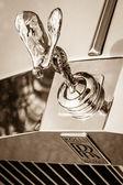 "BERLIN, GERMANY - MAY 17, 2014: The famous emblem ""Spirit of Ecstasy"" on the Rolls-Royce Silver Spirit. Sepia. 27th Oldtimer Day Berlin - Brandenburg — Stock Photo"