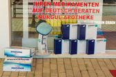Pharmacy. Showcase advertising Viagra. Inscription in German: Consultations in German — Foto de Stock