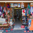 A shop selling souvenirs, clothing and knitwear. Anatolian coast - a popular holiday destination in summer of European citizens. — Stockfoto