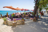 Restaurant on the waterfront. Anatolian coast - a popular holiday destination in summer of European citizens. — Stock Photo