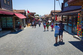 Shopping street in the seaside town. Anatolian coast - a popular holiday destination in summer of European citizens. — Stock Photo