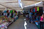 Bazaar in Side. Sale of clothing and accessories. Side - a city on the Anatolian coast, a popular holiday destination in summer of European citizens. — Stock Photo