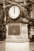 Vintage clock in the town square. Sepia — Stock Photo