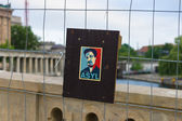 Stylized portrait of Edward Snowden on the fence. Former officer of the CIA and NSA. — Stok fotoğraf