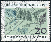 Postage stamp printed in Germany, dedicated to European Nature Preservation Year, shows Mittelgebirge — Stock Photo