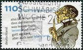 Postage stamp printed in Germany, Lifelong Learning, shows Lehrer Laempel, drawing and quotes by Wilhelm Busch — Stock Photo