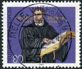 Postage stamp printed in Germany, dedicated to the 500th anniversary of the birth of Martin Luther, engraving by G. Konig — Stockfoto