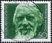 Postage stamp printed in Germany, shows the poet Wilhelm Raabe — Stock Photo