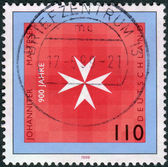 Postage stamp printed in Germany, dedicated to the 900th anniversary of the Knights of St. John of Jerusalem and Knights of Malta — Stockfoto