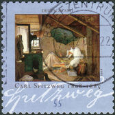 """Postage stamp printed in Germany, shows the painting """"The Poor Poet"""" by Carl Spitzweg — Stock Photo"""