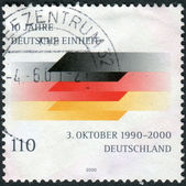 Postage stamp printed in Germany, dedicated to the 10th anniversary of the Reunification of Germany — Stockfoto