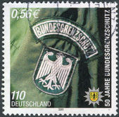 Postage stamp printed in Germany, dedicated to the 50th anniversary of the Federal Border Police — Stock Photo