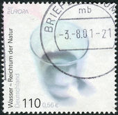 Postage stamp printed in Germany, dedicated to the protection of the environment, shows a water glass — Stock Photo