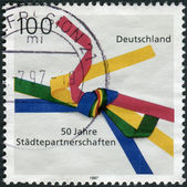 Postage stamp printed in Germany, dedicated to the 50th anniversary of the Sister Cities Movement — Stockfoto