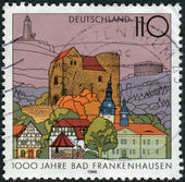 Postage stamp printed in Germany, dedicated to the 1000th anniversary of the Town of Bad Frankenhausen, Ursberg — Stockfoto