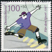 Postage stamp printed in Germany, shows the Inline skating — Stock Photo