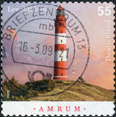 Postage stamp printed in Germany, shows a lighthouse Amrum (built in 1873) — Stock Photo
