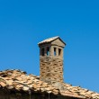 Old brick chimney against the blue sky. — Stock Photo #51755345