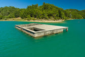 Green lake in the Taurus Mountains. Flooded building in the reservoir. Oymapinar. Antalya Province. Turkey. — Stock Photo