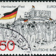 Postage stamp printed in Germany dedicated to the 150th anniversary of the Hambach Festival, shows a Procession to Hambach Castle — Stock Photo #51762081
