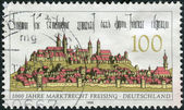 Postage stamp printed in Germany, dedicated to the 1000th anniversary of Freising's Right to Hold Markets, shows a city view from the engraving (1642) by Matthaeus Merian — Stockfoto