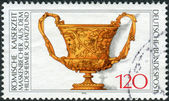 Postage stamp printed in Germany, shows a Roman cup with masks, 1st century AD — Stock Photo