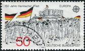 Postage stamp printed in Germany dedicated to the 150th anniversary of the Hambach Festival, shows a Procession to Hambach Castle — Stockfoto