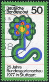 Postage stamp printed in Germany, dedicated to the 25th Federal Horticultural Show, Stuttgart, is depicted Flower Show emblem — Foto de Stock