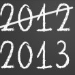 2012 crossed and new year 2013 on chalkboard — Stock Photo #13282965
