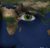 Earth painted on face with green eye — Stock Photo
