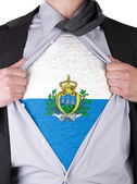 Business man with San Marino flag t-shirt — Stock Photo