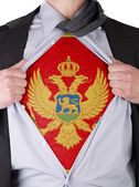 Business man with Montenegrin flag t-shirt — Stock Photo