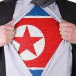 Business man with North Korean flag t-shirt — Stock Photo #19496499