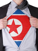 Business man with North Korean flag t-shirt — Stock Photo