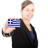 Business woman holding a card with the Greek flag — Stock Photo