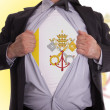 Business man with Vatican City flag t-shirt - Stock Photo
