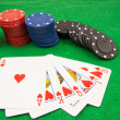 Stack of chips and a royal flush — Stock Photo #22009185