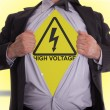 Business man with high voltage t-shirt — Stock Photo