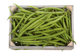Wooden crate with Fresh green beans viewed from above — Stock Photo