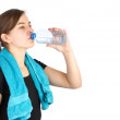 Woman in sportswear drinking water — Stock Photo
