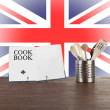 Cookbook and kitchen utensils with English flag — Stock Photo