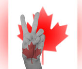 Hand peace sign with flag of Canada — ストック写真
