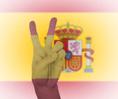 Hand peace sign with flag of Spain — Stock Photo
