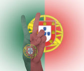 Hand peace sign with flag of Portugal — Stock Photo