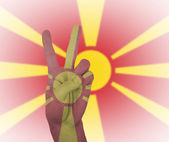 Hand peace sign with flag of Macedonia — Stock Photo