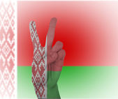 Hand peace sign with flag of Belarus — Stock Photo