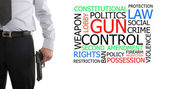 Armed man next to gun control word cloud — Stock Photo