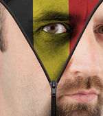 Unzipping face to flag of Belgium — Stock Photo