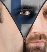 Unzipping face to flag of Finland — Stock Photo